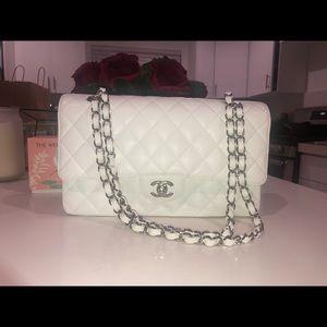 Chanel white caviar class double flap bag.